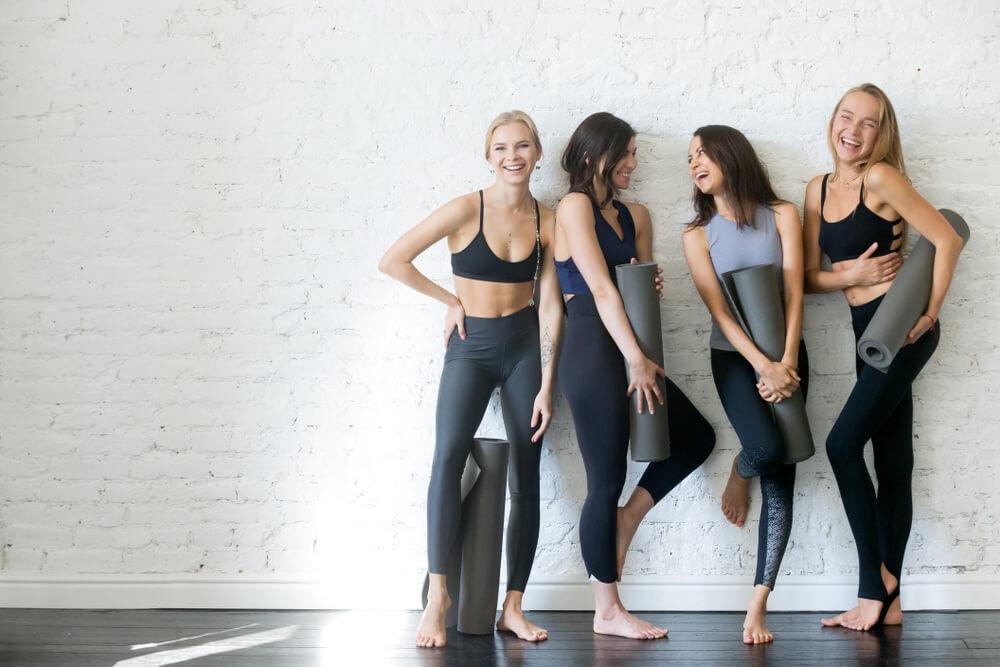 Women holding yoga mats