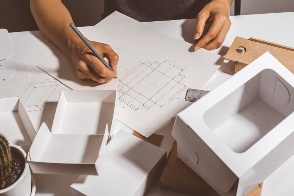 Man designing private label packaging