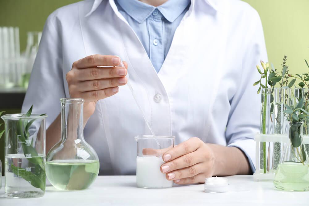 Scientist working on formula in lab